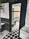 luxe grote spiegel met radiator